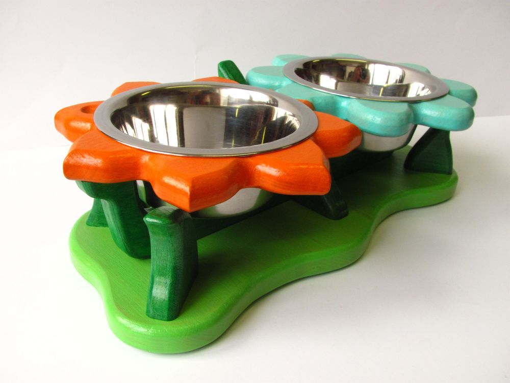ZINNIA OG funky dog bowl stand via Cc2K-design   Funky dog/cat bowl stand and ceiling lights.. Click on the image to see more!