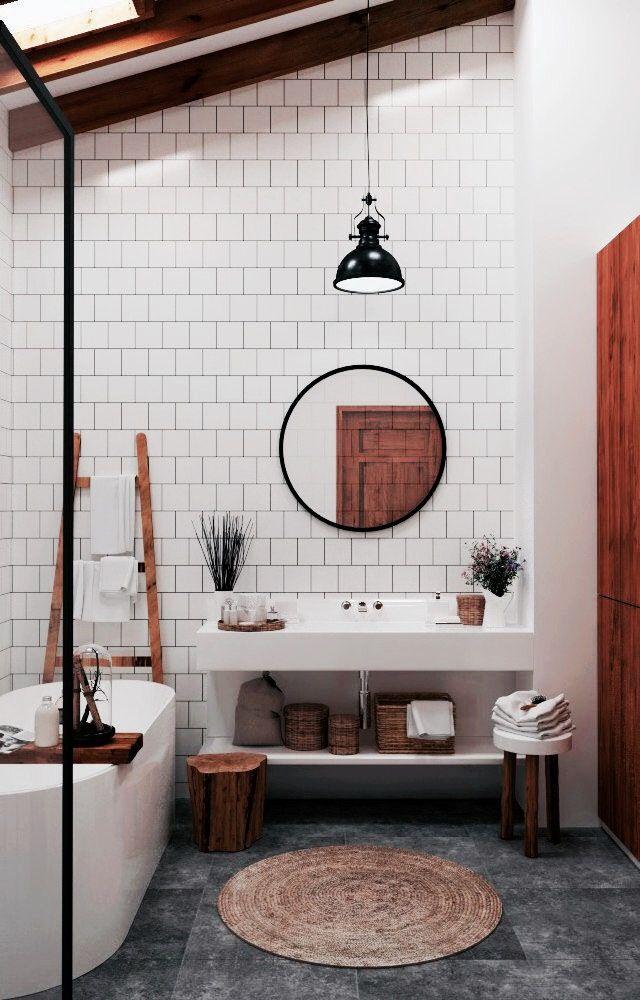 Schlichtes minimalistishes Badezimmer mit weißen versetzten Fliesen