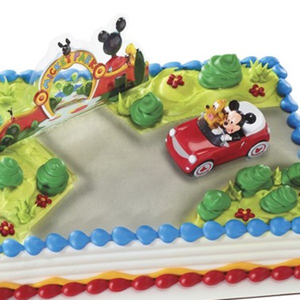 Mickey Mouse and Pluto cake decorating kit Available at local