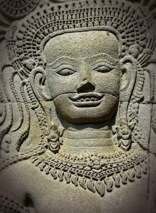 The only Devata of Angkor Wat showing her teeth