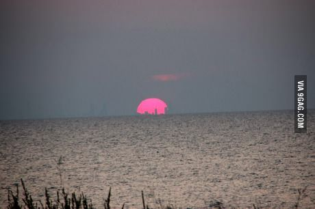 Sunset over Lake Michigan August 7. the silhouette of Chicago inside the sun