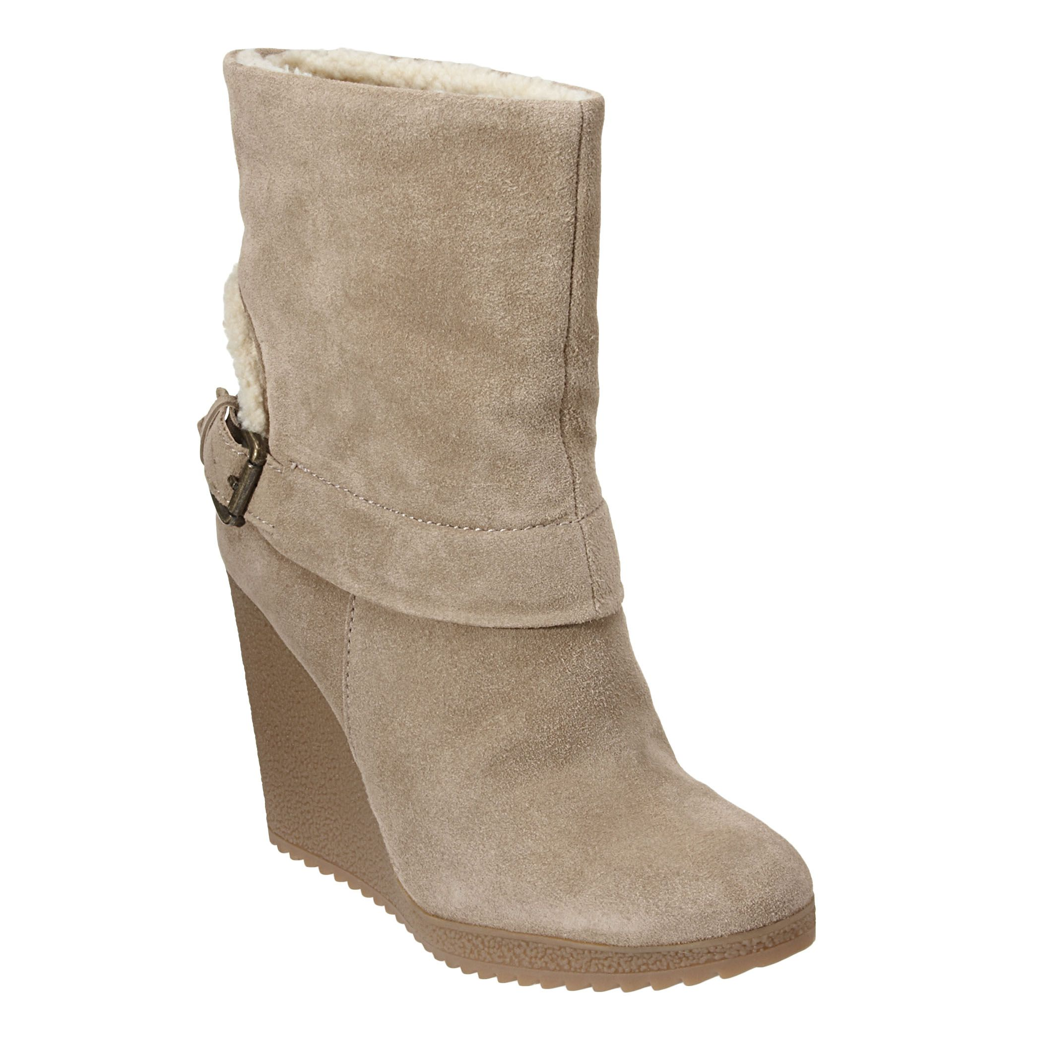 "Almond toe bootie with faux shearling accent.  Buckle detail.  Rubber 3 3/4"" wedge and 1/2"" platform."