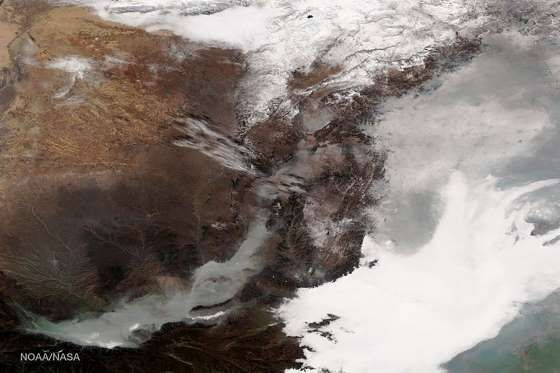 SMOG Smog hangs thick in the air of eastern China. This photograph was taken by the Suomi NPP satellite's VIIRS instrument.