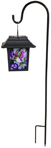"""Continental Art Center NS2218B Four Sided Stained Glass Solar Lantern, Purple Hummingbird, 29.5-Inch by Continental Art Center. $27.52. Exclusive Designs: Purple Hummingbird. Size of the Lantern: 5.75""""x5.75""""x6.5"""". Stand: 29.5"""". On and Off Switch. LED Lighting. Rechargeable Batteries are Included. Four Sided Hand Painted Stained Glass Solar Lantern. Comes with A 29.5"""" Tall Stand. Powder Coated Metal is Weather Proof. Stand Can Be Disassembled in Three Parts for Easy S..."""