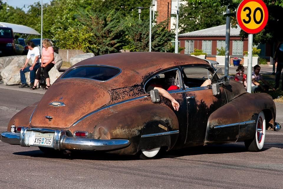 sweet 40s chevy coupe rat rod slammed and rocking some wide white wall tires around red