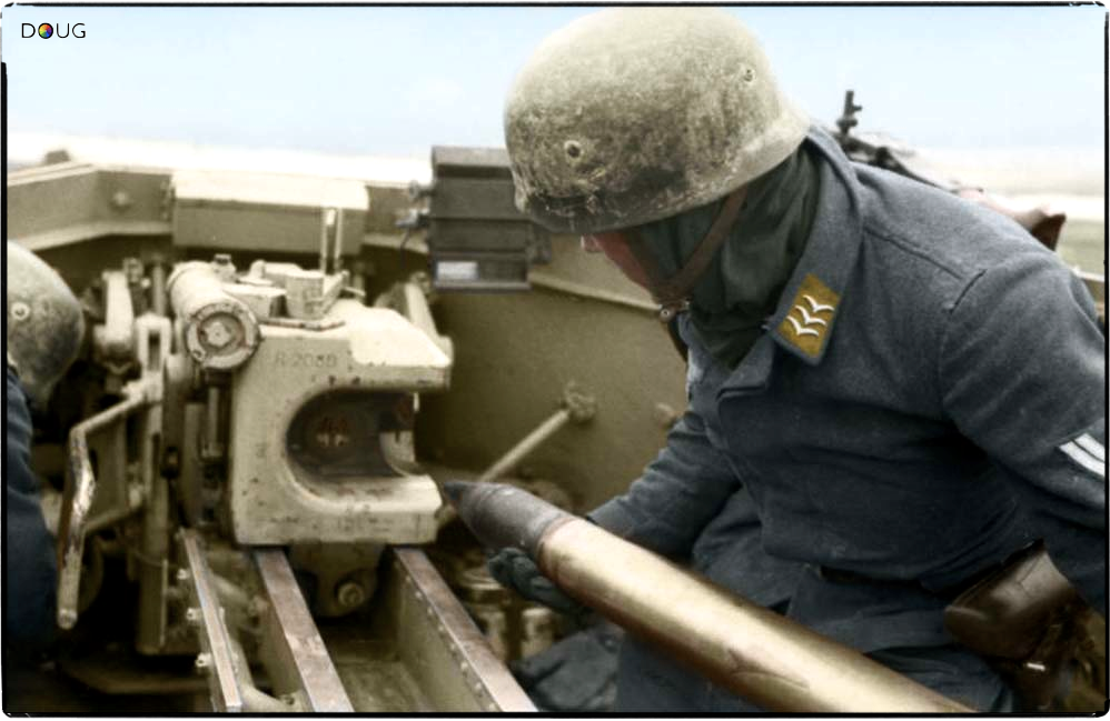 A Fallschirmjäger Obergefreiter loading a 75mm round into the breach of a PaK 40 anti-tank gun mounted on a Marder II (Sd.Kfz. 131), somewhere in Russia, March 1943.