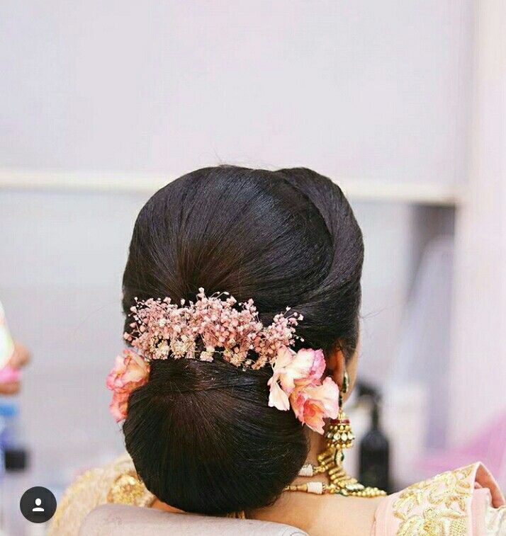 What A Beautiful Large Low Bun With Real Flower Gajra Care However Should Be Taken Before Adopting Bridal Hair Buns Indian Bridal Hairstyles Long Hair Styles