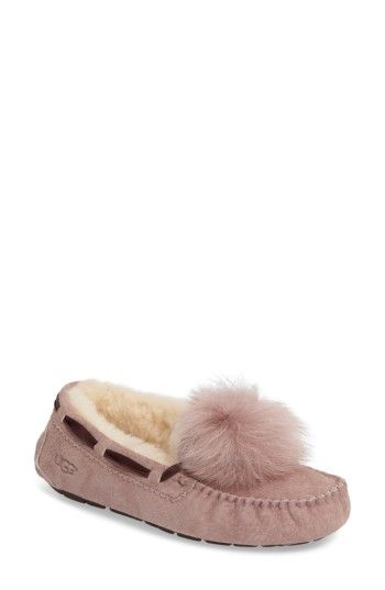e1e4eb72ff6 Free shipping and returns on UGG® Dakota Genuine Shearling Pompom Slipper ( Women) at Nordstrom.com. A flexible rubber sole adds indoor outdoor  versatility ...