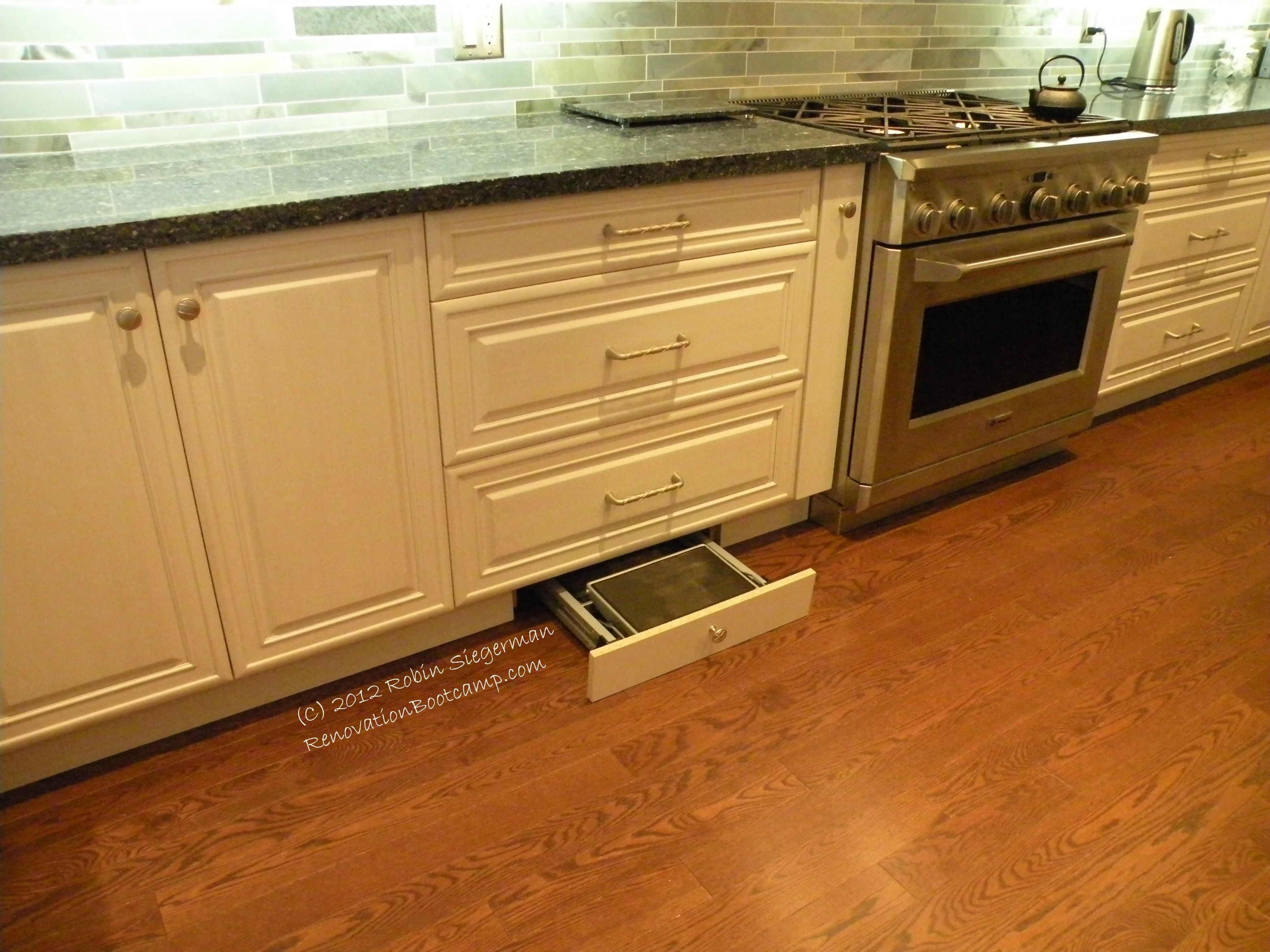 I used the toe kick space under a #kitchen #cabinet to hide a ...