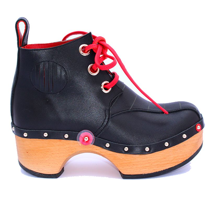 A classic black ankle boot exuding rock'n'roll coolness that can also create a tough yet feminine style when teamed up with a print dress. Features: • handcrafted • three large eyelets • hand grooved pattern on the front tongue panel • vented ankle detail for flexibility • handmade red leather laces • natural leather • …