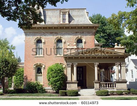 old fashioned brick house with mansard, hipped roof & corinthian