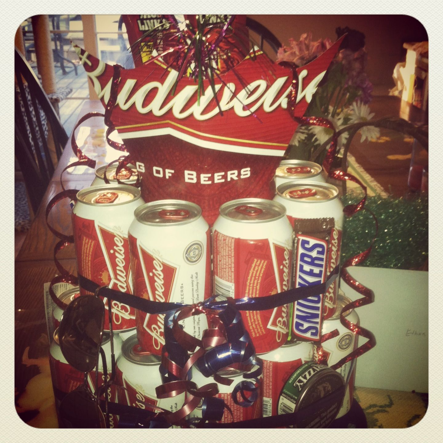 Budweiser beer cake! Stuffed with gas card, lotto tickets, beef jerky, aviators, gift card, snickers, chew! Mans cake...