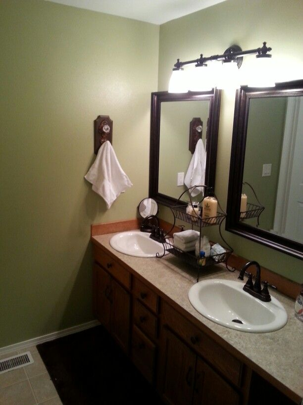 bathroom remodel moss green paint antique bronze mirrors faucets and fixtures bathroom remodel mirrors