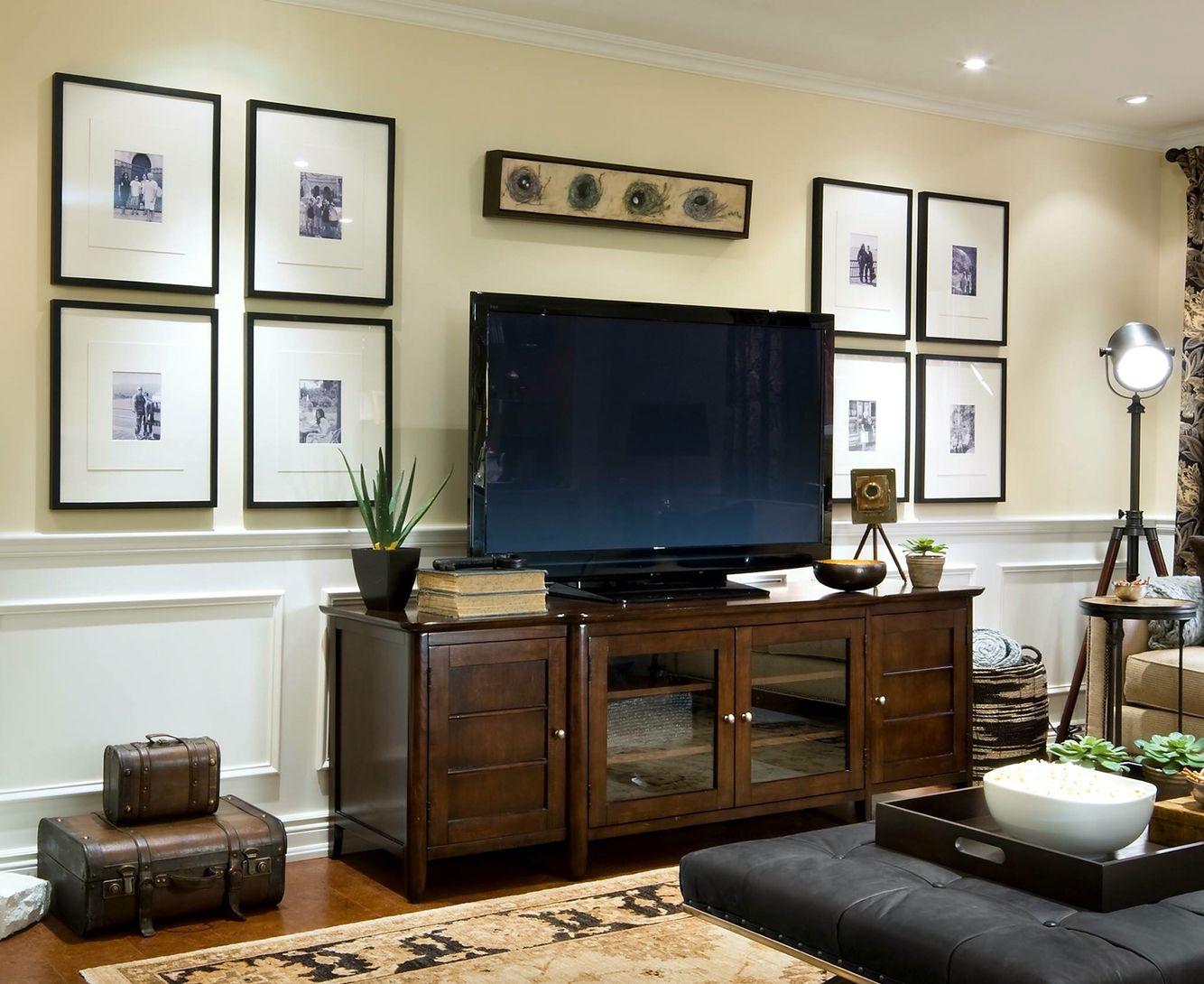 Tv in gallery wall symmetrical design | Living room tv ...