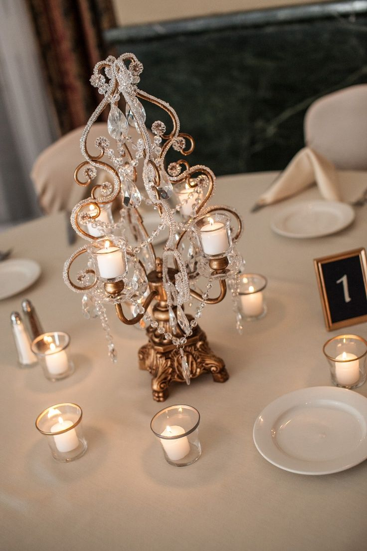 I love love love these centerpieces no flowers but just as pretty candleabra wedding centerpieces a simple and gorgeous centerpiece photo by chris ifrom minneapolis wedding photographers arubaitofo Image collections