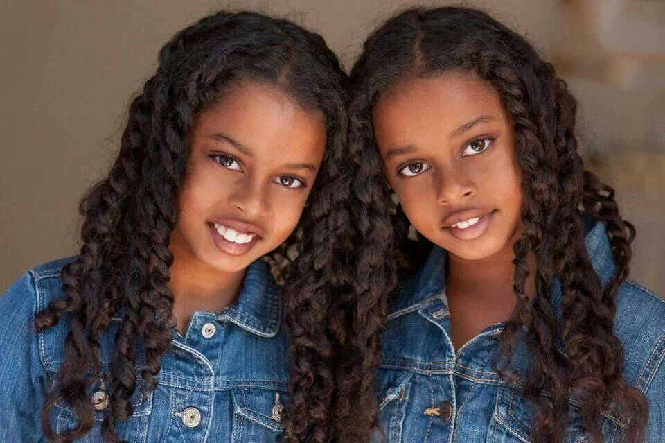 Excited identical twin girls congratulate, seems
