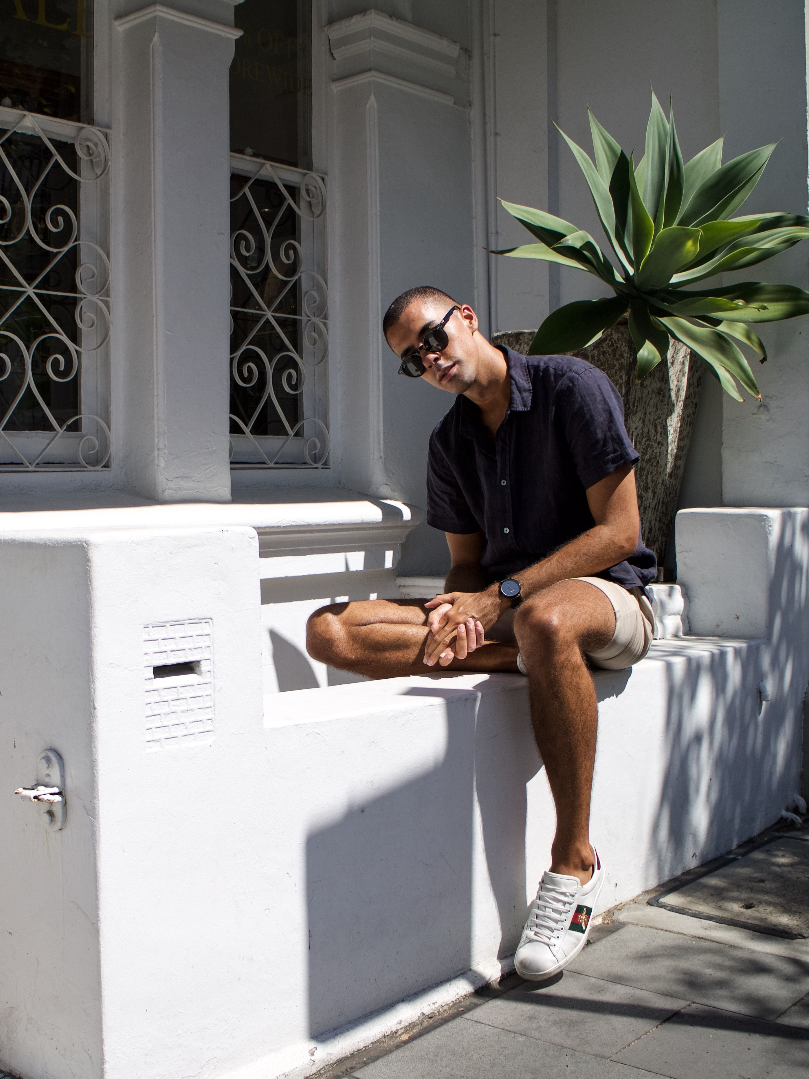 0ae924284 Mens Fashion Style & Outfit inspo by Blogger MR TURNER. Assembly Label  linen shirt in Navy Blue and Topman fitted chino shorts. Gucci Ace Sneaker.