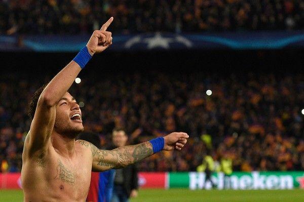 Barcelona's Brazilian forward Neymar celebrates at the end of the UEFA Champions League round of 16 second leg football match FC Barcelona vs Paris Saint-Germain FC at the Camp Nou stadium in Barcelona on March 8, 2017. / AFP PHOTO / LLUIS GENE