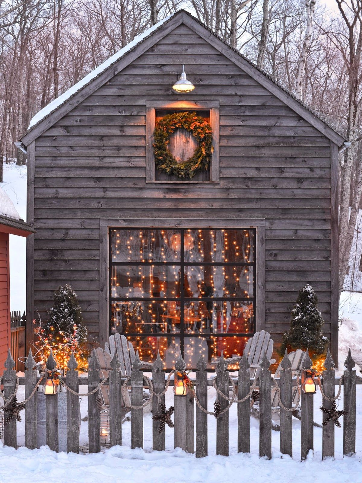 natural rustic outdoor christmas decorating i love the rope garland with pinecone stars hanging from the picket fence karin lidbeck outdoor spaces
