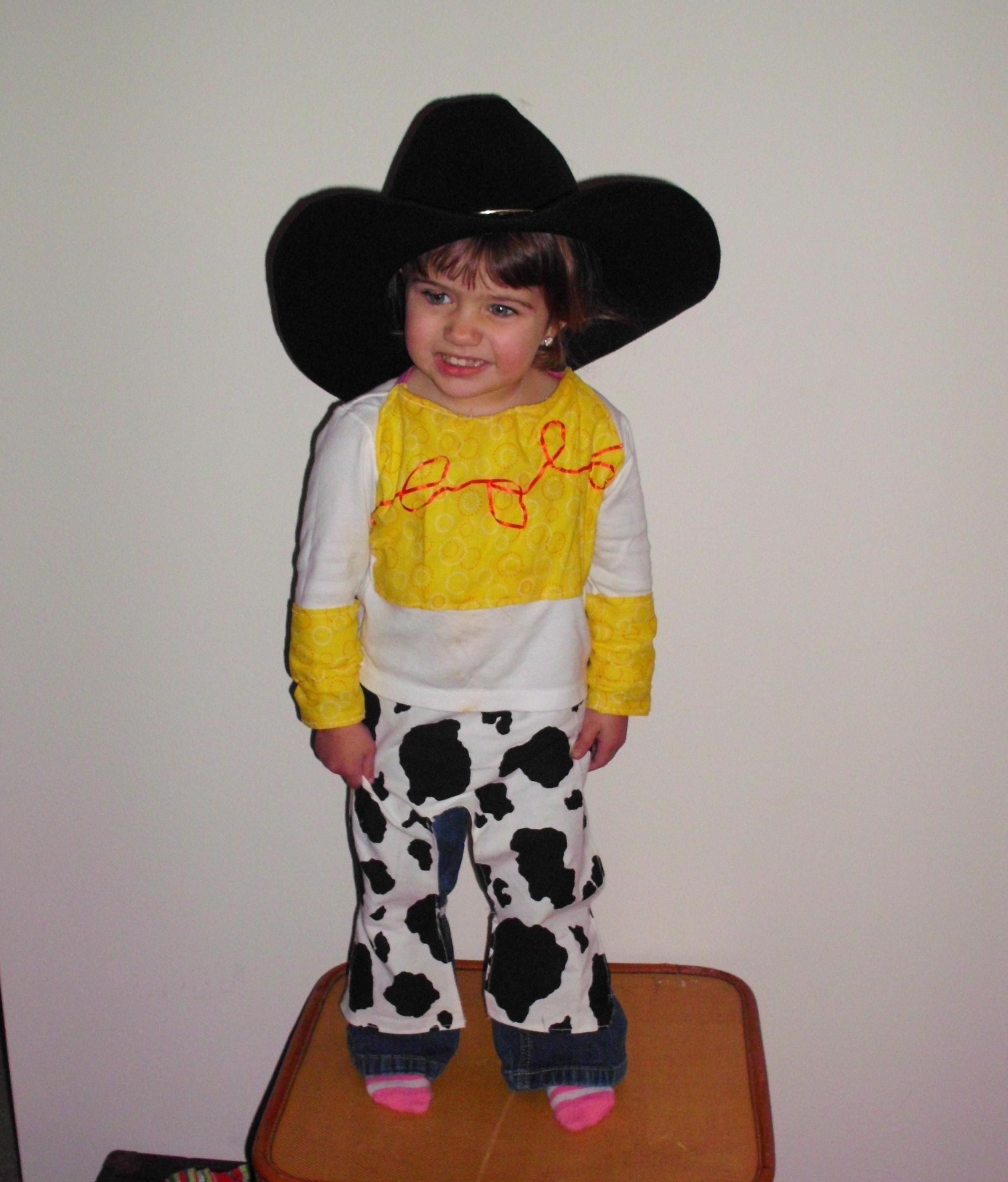 Jessie the cowgirl, I made little cowhide stirups...took an old white shirt and add the yellow and red...And you have Jessie