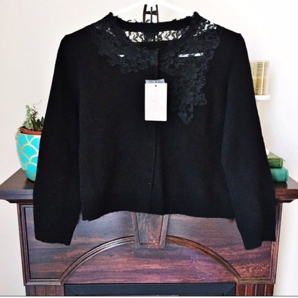 ⚬Urban Outfitters⚬Wool Cropped Cardigan This beautiful Kimchi Blue 100% lambswool black cropped cardigan is perfect for the upcoming holidays! Features lace cascading details, hidden snap closure buttons and 3/4 sleeves. Would look great over a dress! Brand new with tags and extra button + thread, $88 at UO! I'm a ⚡️ shipper and do bundle discounts. Urban Outfitters Sweaters Cardigans
