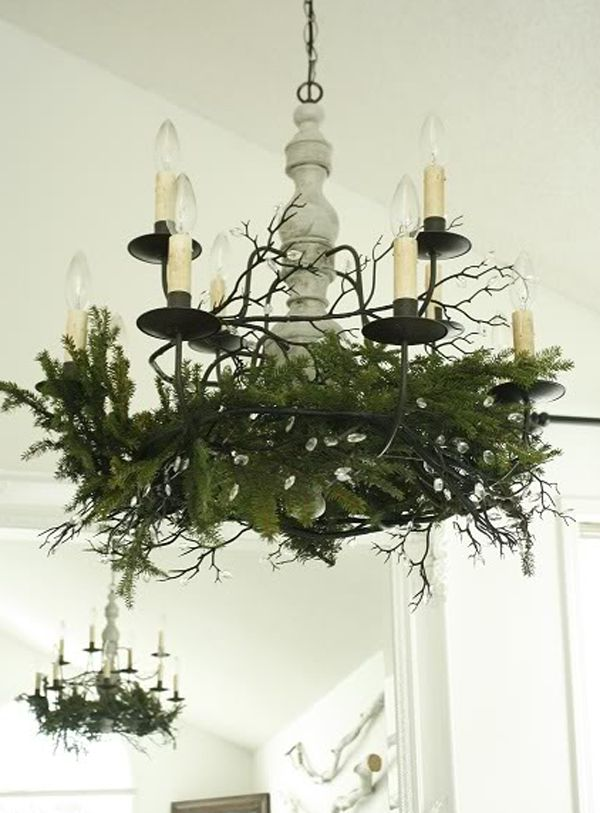 White christmas dining room ideas with creative chandeliers 2 i always love to decorate chandeliers with evergreens at christmas such a beautiful natural look aloadofball Image collections