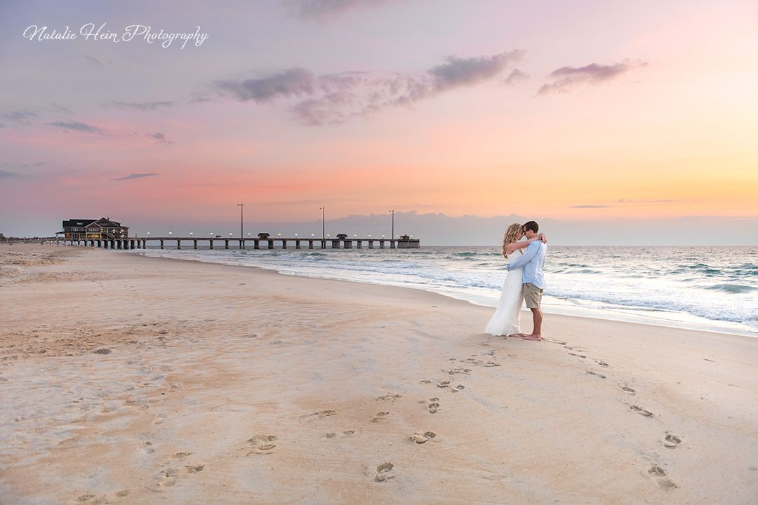 Sunrise beach wedding Bride and Groom portrait.  www.natalieheimphotography.com