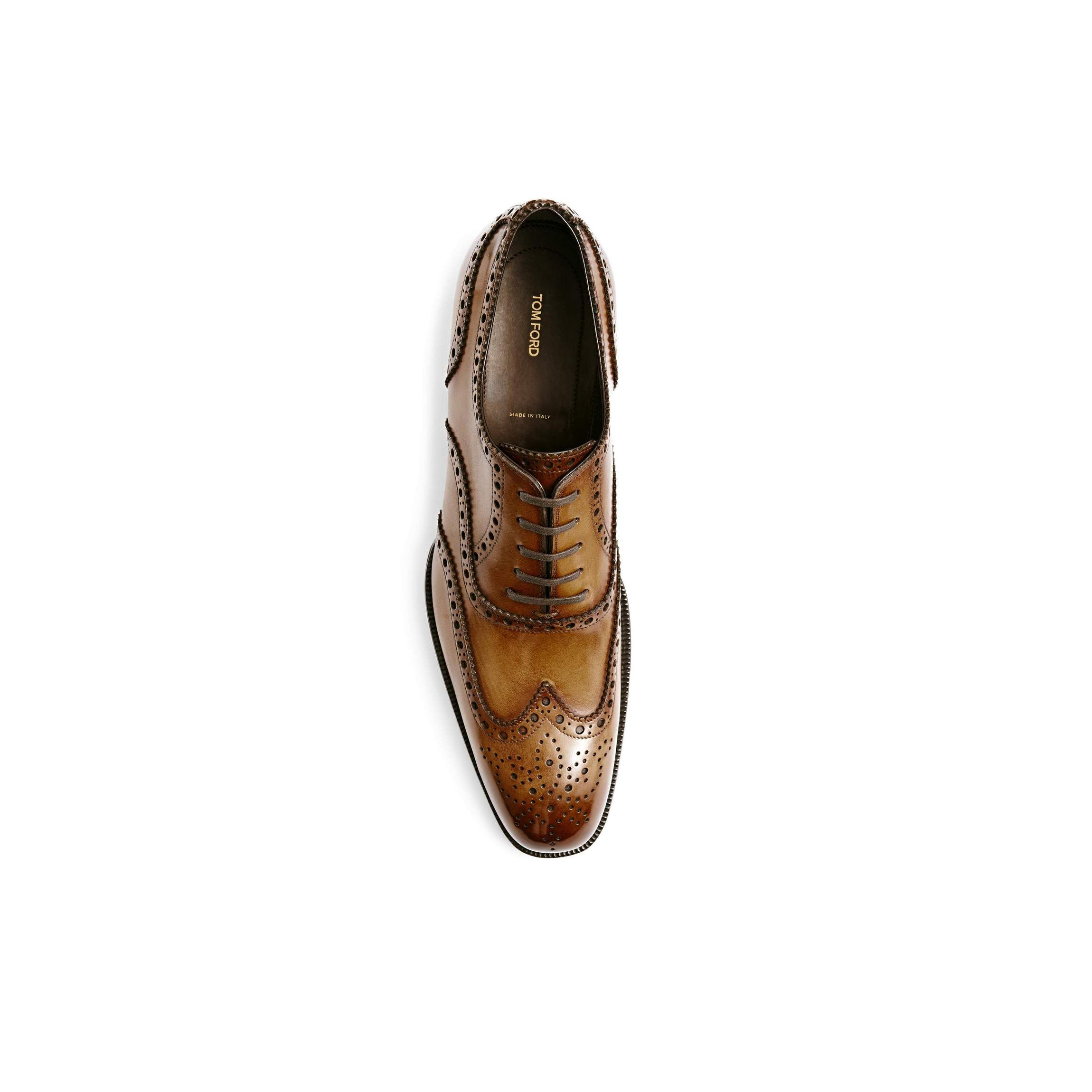 Tom Ford Edward hand-polished brown burnished leather French brogue wingtip lace-up.