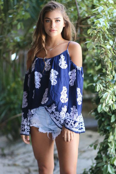 Stylish navy printed top with bell sleeves. Arrow Point features a cold shoulder design with adjustable straps and a three button closure at front. Material is