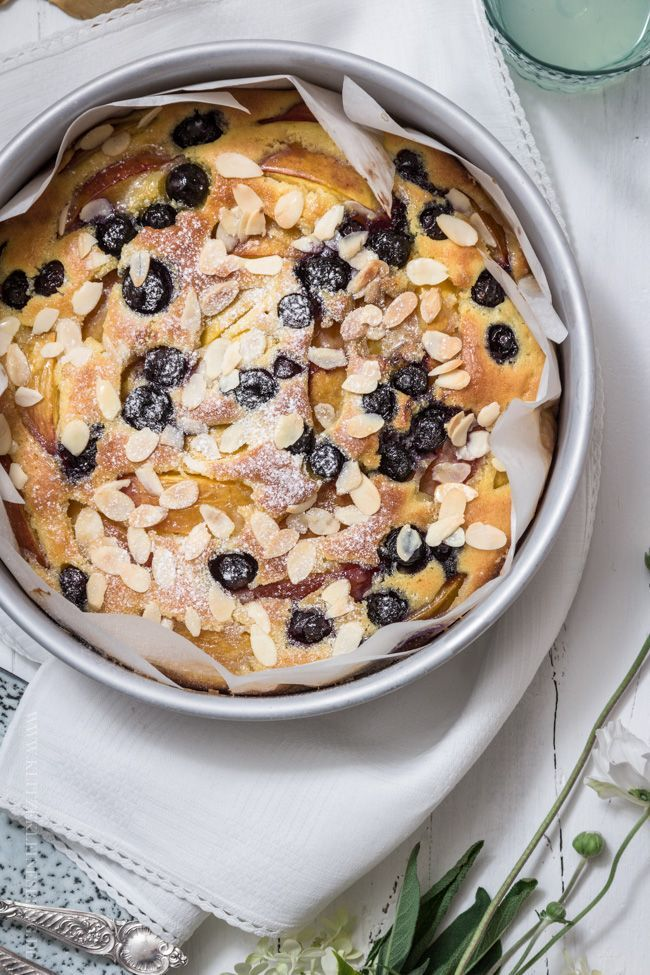 Nectarine and blueberry cake with butter icing and toasted almonds