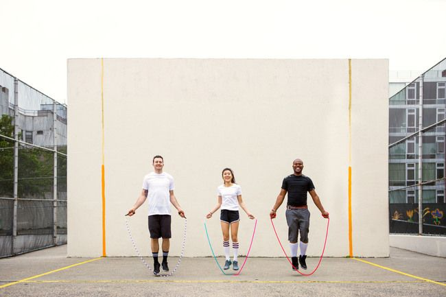Young adults skipping rope in the park