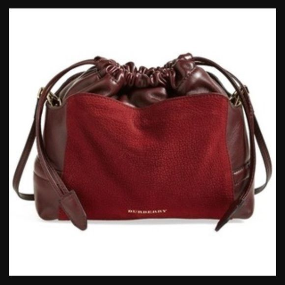NWT Burberry Little Crush Crossbody NWT Burberry 'Little Crush' Crossbody purchased from Nordstroms! Leather and Suede, color is deep claret. Bold, trademark check pattern inside, gold-colored hardware and adjustable Crossbody strap. Drawstring, slouchy opening is 100% on trend! Great buy at almost 50% off retail!!! Burberry Bags Crossbody Bags