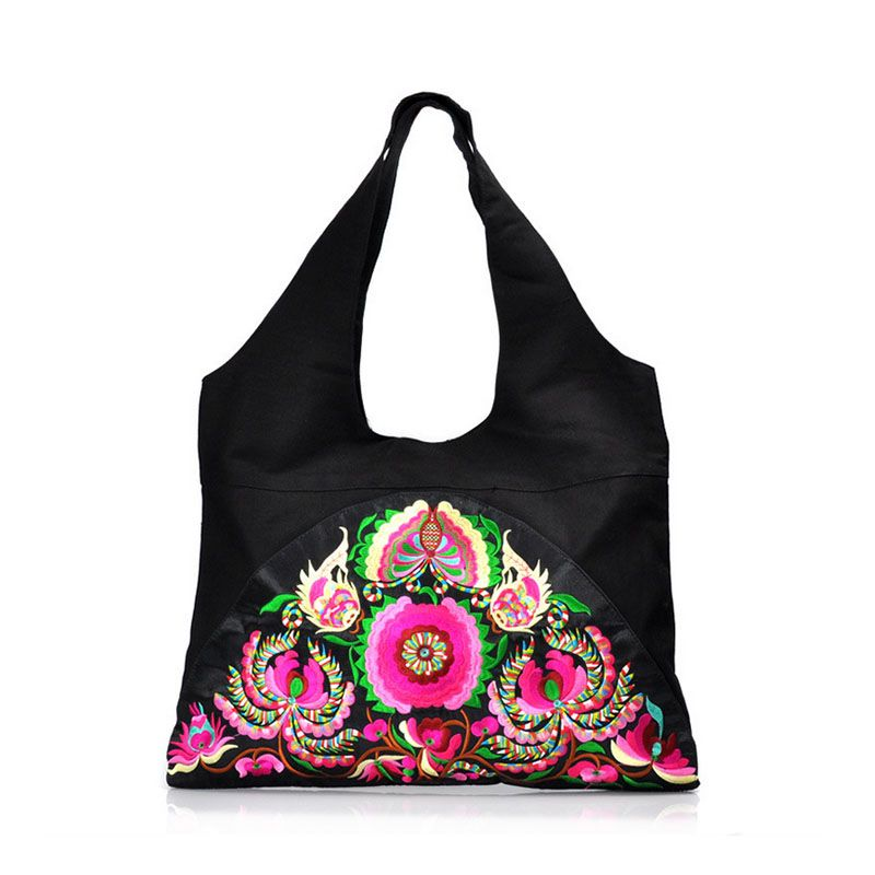 This brightly colored Canvas Tote Bag measures approximately 22 x 17 inches  and is sure to turn heads with it s intricate embroidered design. 8869cc153f2b9