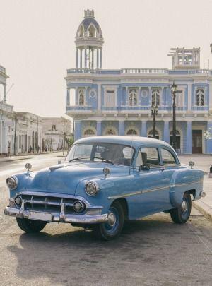 A classic car outside Ferrer Palace, Cienfuegos, Cuba.