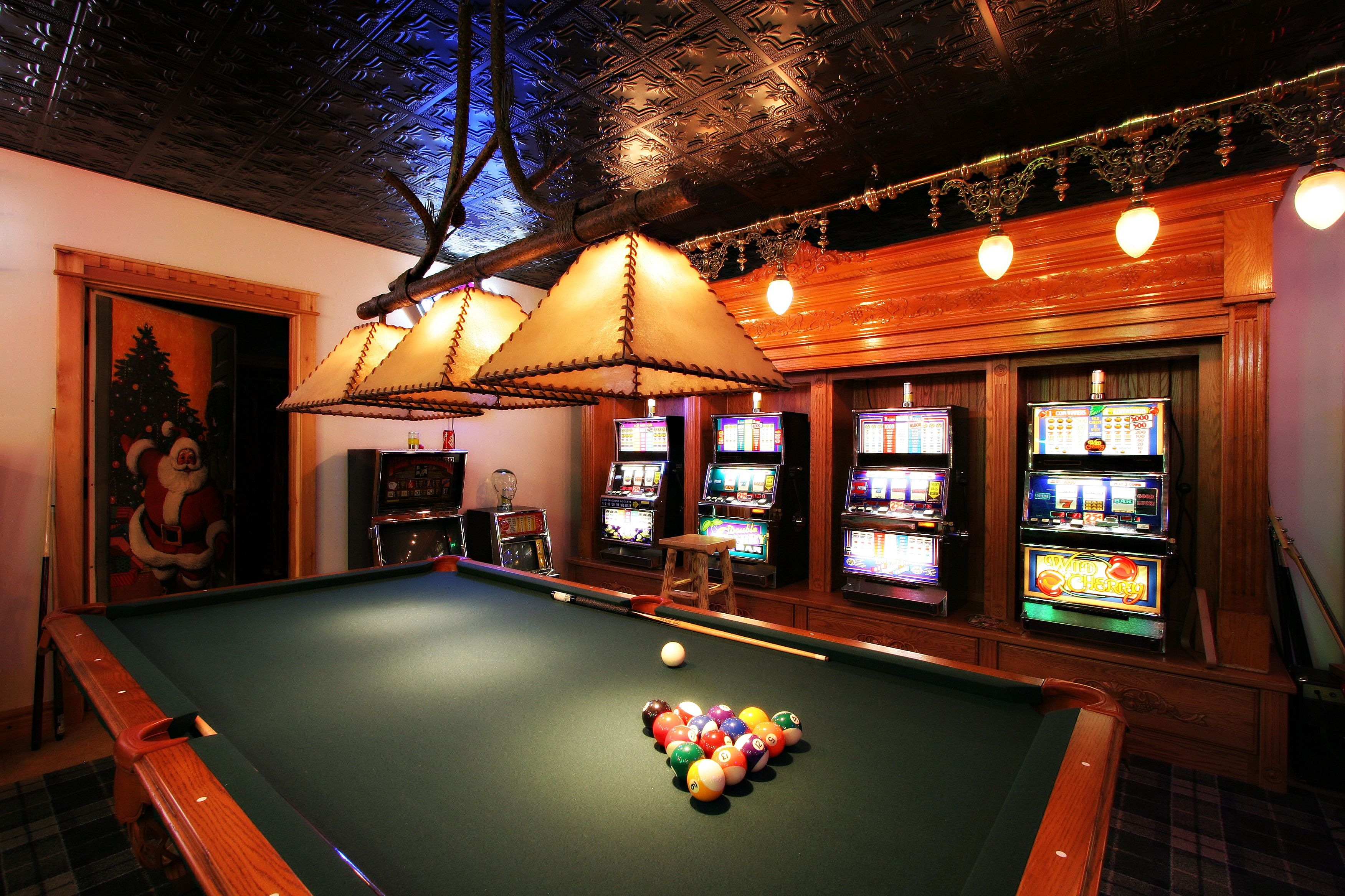 Pool Table And Slot Machines In A Basement Game Room Game Room