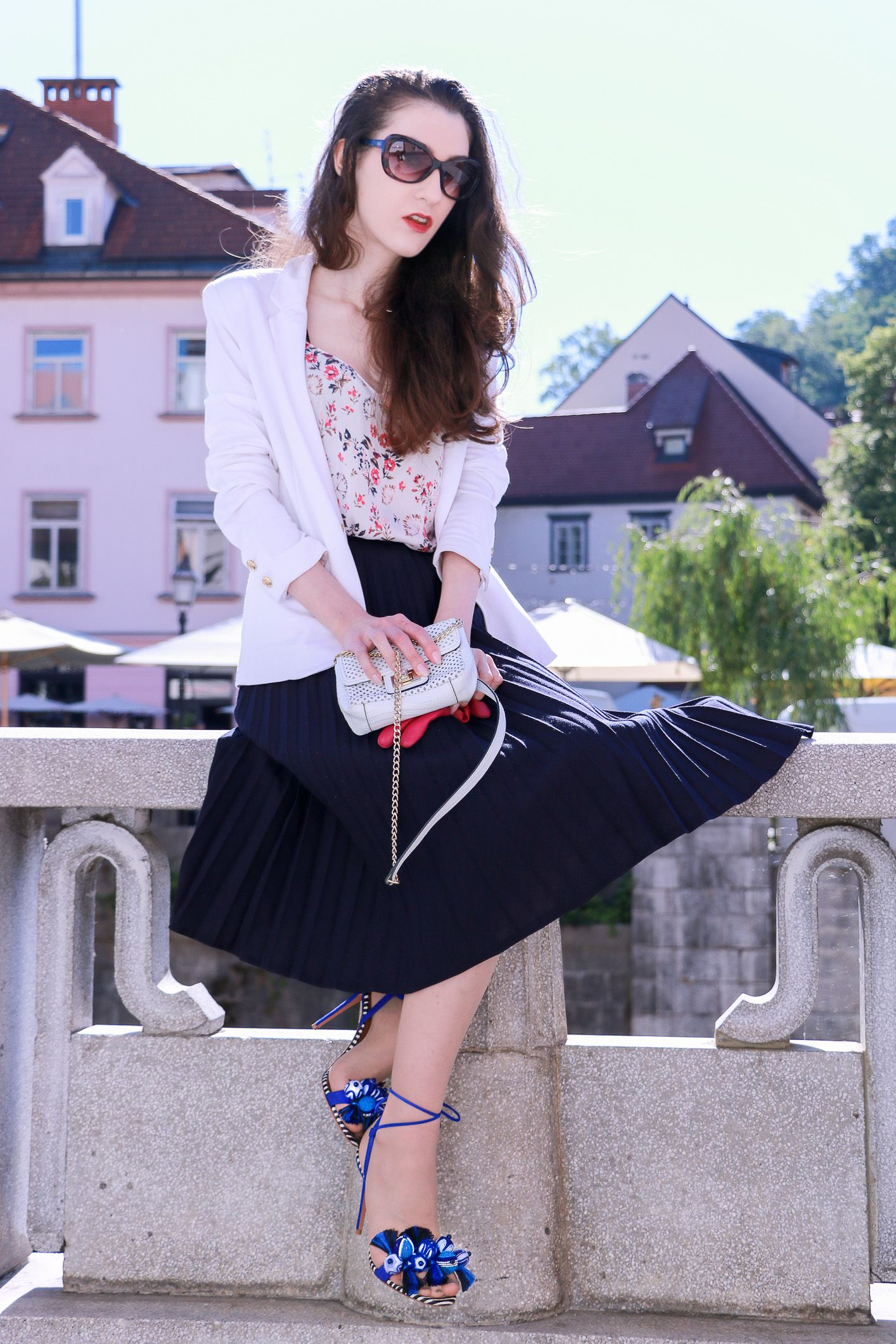 968c1352ca Fashion blogger Veronika Lipar of Brunette From Wall Street sharing how to  style black vintage midi