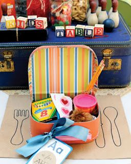 This is a fun way to present an activity bag to your kiddo guests. Emily Weddings: DIY Friday: The Kids Table