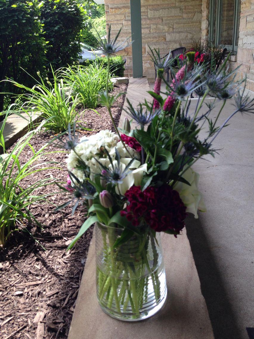 Tulips, blue thistle, lisiantha