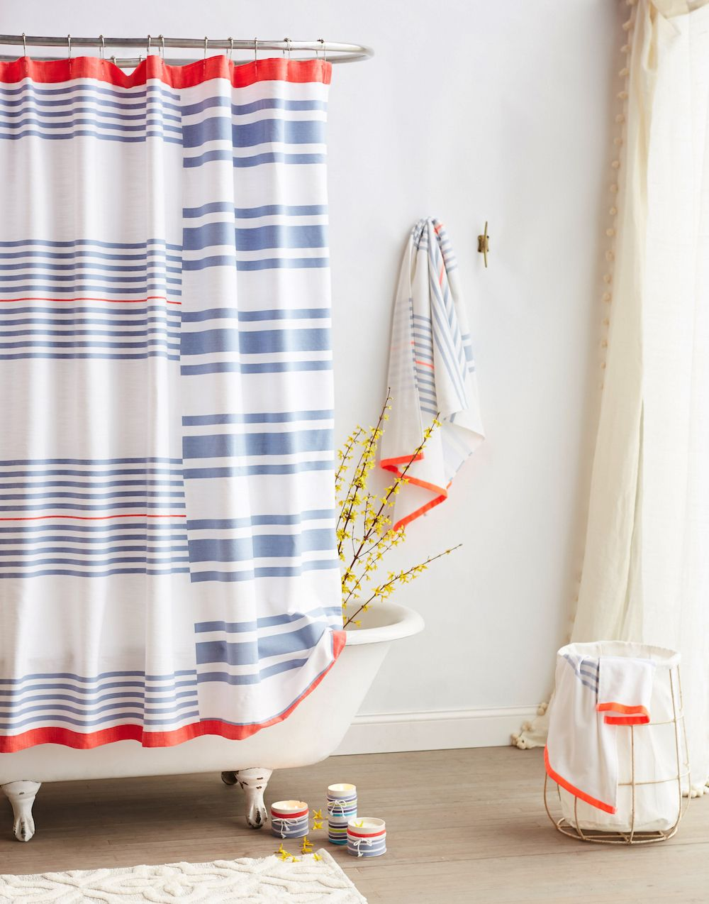 Striped Shower Curtain And Hints Of Orange In Bathroom