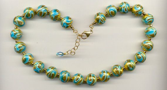 Hey, I found this really awesome Etsy listing at https://www.etsy.com/listing/259569056/aqua-oro-turquoise-swirls-14mm-round