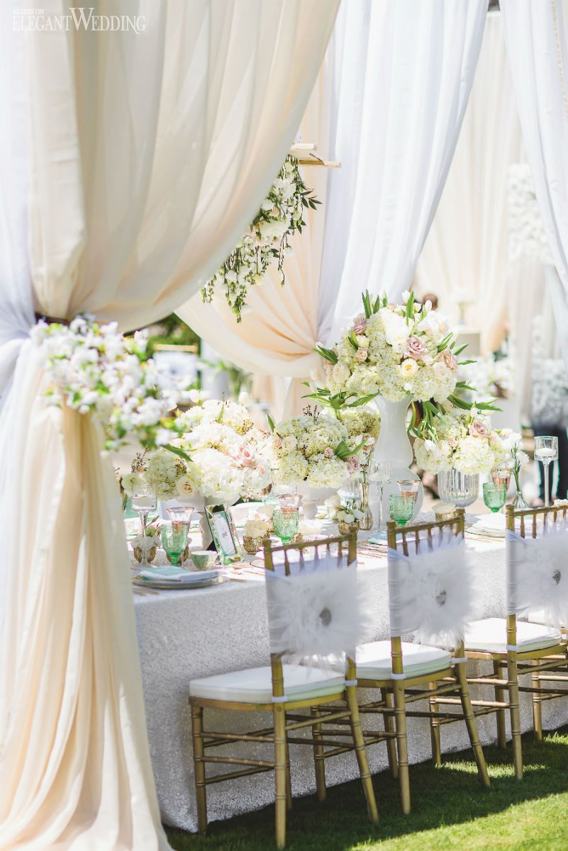 White feathery draped wedding table setting, feather chair covers ...