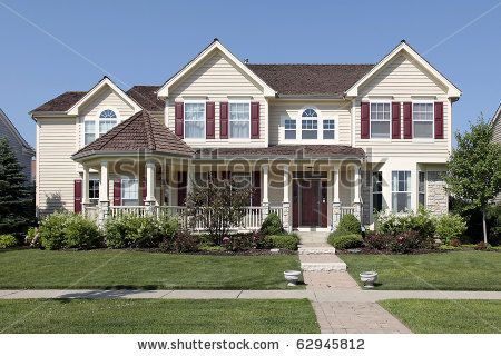 Yellow Houses With Red Shutters Large Suburban Home Siding And Stock Photo