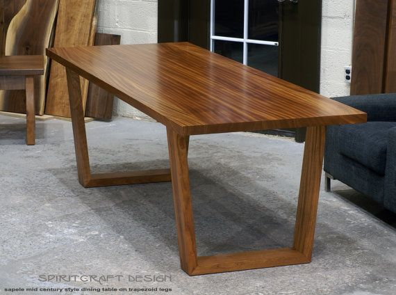 A Custom Sapele Mahogany Dining Table On Mid Century Modern
