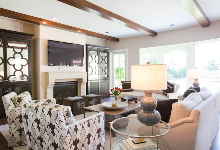 Chic Living Room Design With Exposed Wood Beams, TV, Limestone Fiireplace,  Espresso Mirrored