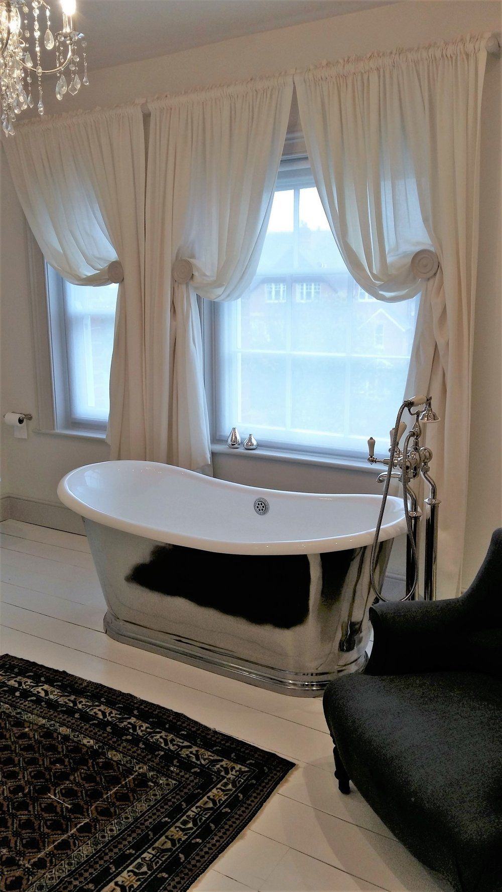 Gathered Sheer Curtains Look Very Opulent In A Traditional Bathroom. Held  Back By Wooden Holdbacks