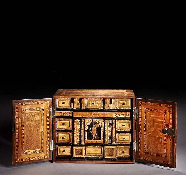 Secretary Cabinet  from walnut burl and fruitwood, carved and ebonized marquetry façade. two doors reveal an interior fitted with 10 drawers and a central decoration of a Knight. South Germany.17th century  39.5cm h.