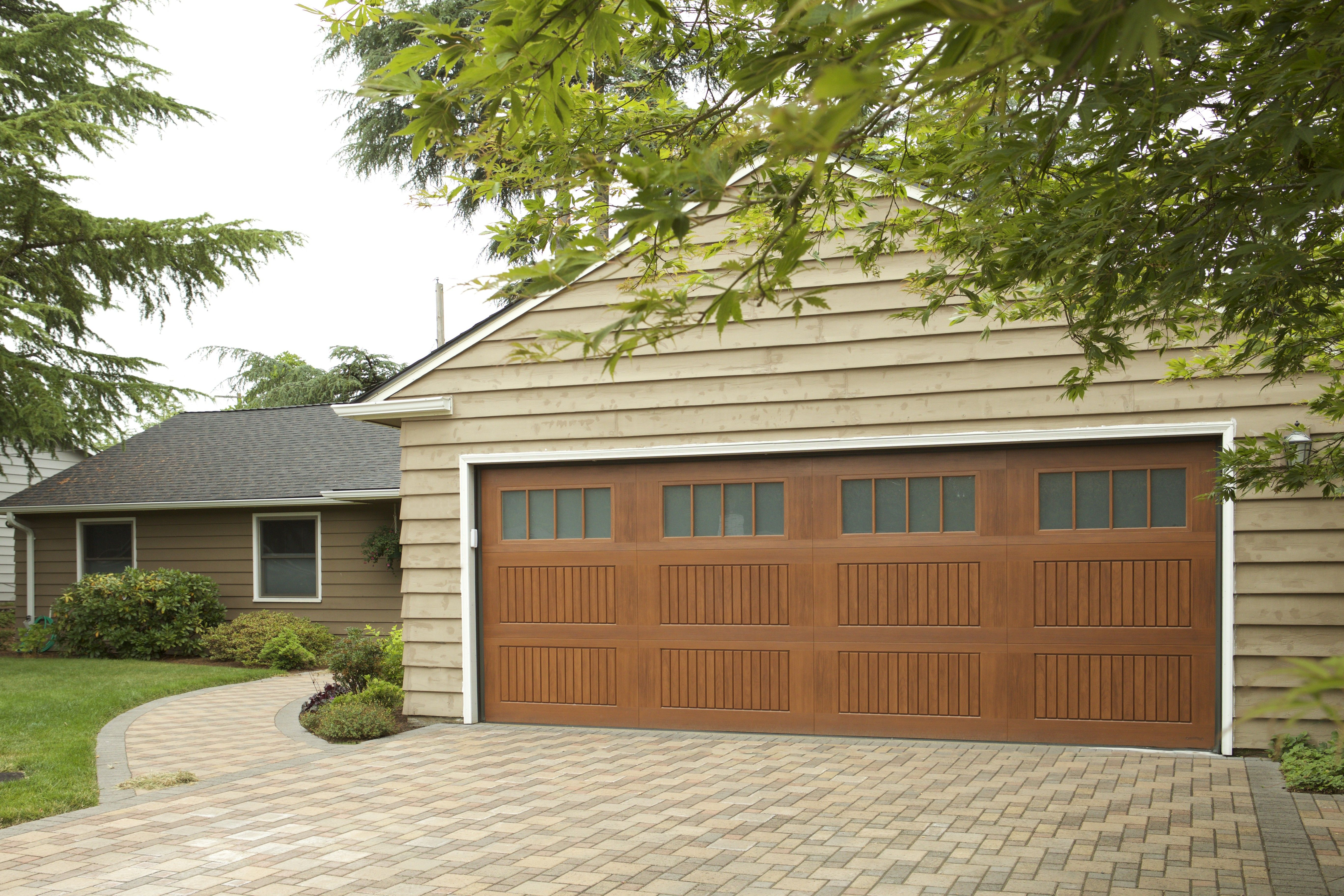 Beautiful Faux Wood Garage Door In 2020 Wood Garage Doors Fiberglass Garage Doors Garage Doors