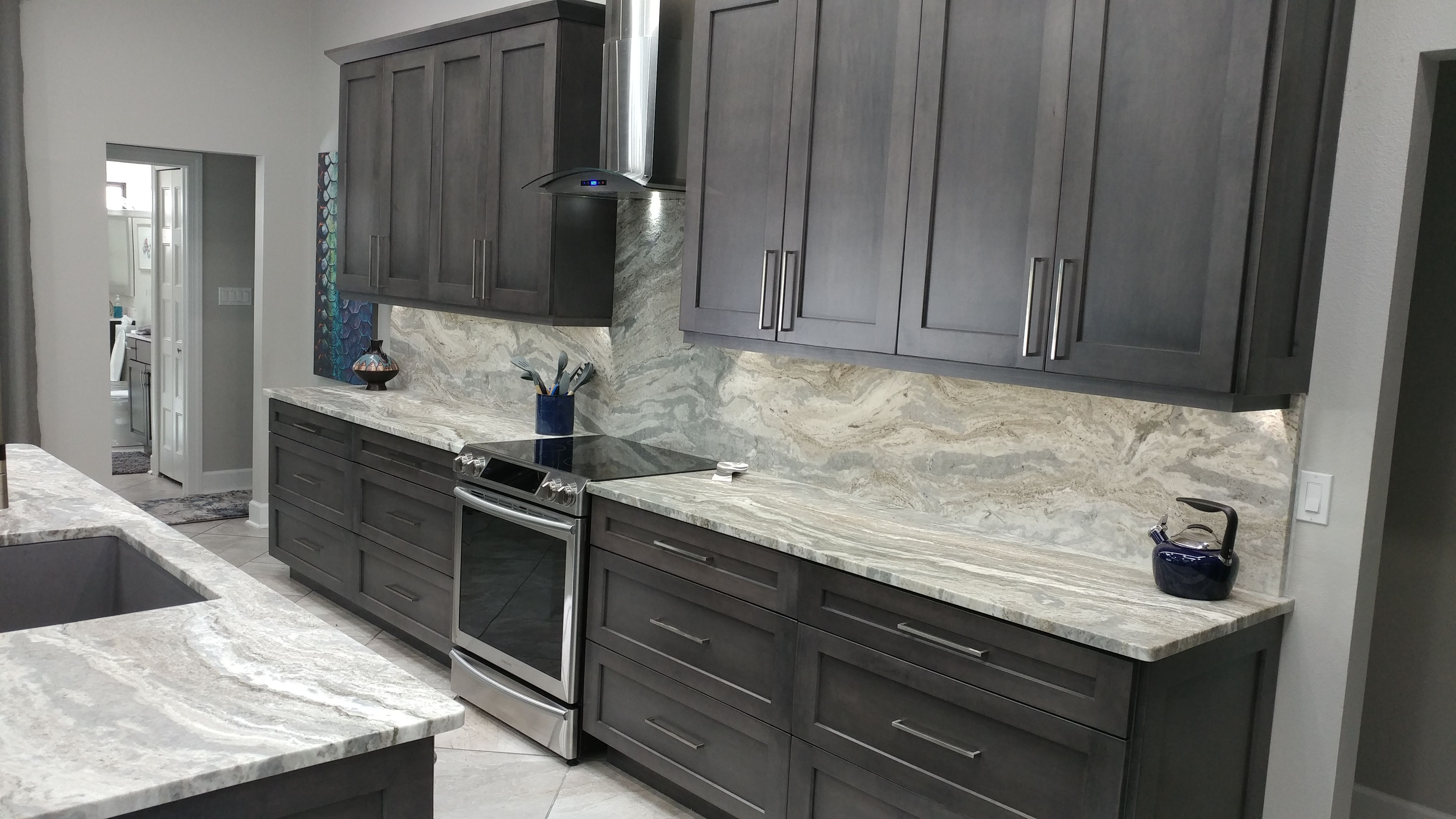 From This Angle You Can Appreciate The Hand Rubbed Slate Finish On The Shaker Euro Style Cabinets By Eudora And Stunning F Cabinet Styles Slate Kitchen Cabinet