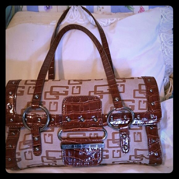 Beautiful Guess crocodile skin  HOLD Guess hand bag. Like new  Has pocket inside and outside No scratches or tear s Guess Bags Totes