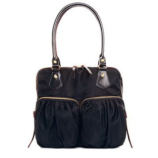 Our best seller, Jane is our ultimate everyday bag that will take you from work to dinner to weekend, season after season. Features rolled Italian leather handles with a shoulder length drop. Pictured in our classic black Bedford Nylon, with custom MZ Wallace gold hardware and finished with our signature red edge-dye, perfect for year round wear.
